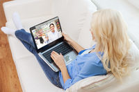 woman having video chat with pharmacist on laptop