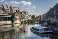 Ghent, Belgium - June 13, 2017: Tourists enjoy a boating trip on the river in the old city