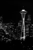 Black and white image of the lights of the Seattle skyscrapers at night.