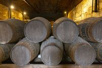 barrel filled with port wine in wine cellar
