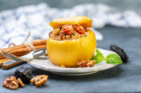 Baked apple with cottage cheese, fruit and nuts.