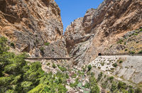 Path (Caminito del rey) along steep cliffs, rocks and mountain river in Spain