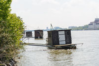simple wooden boat on the shore - barrack serves as houseboat