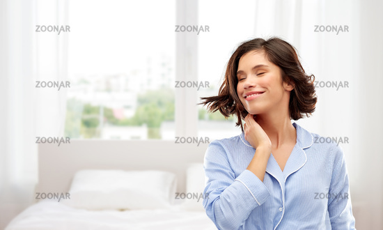 happy young woman in pajama over bedroom