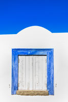 historic algarve architecture building with blue framed window