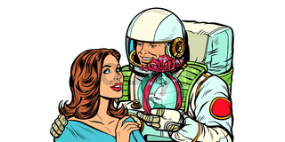 Couple in love. Astronaut gives a woman the Earth isolate on white background