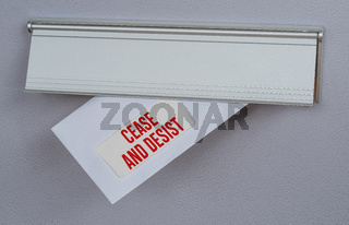 A letter in a mail slot - Cease and Desist