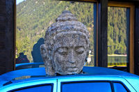 Head, stone torso of a Bhuddist prince on a car, Switzerland