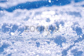 Texture of ice in winter. Pieces of frozen water on a street in