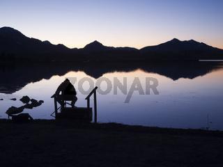 Angler silhouette at the bavarian Lake