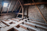roof beams in attic / loft during before renovation / construction