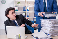 Two male colleagues unhappy with excessive work