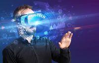 Businessman looking through VR glasses