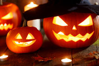 Halloween pumpkins with witches hat