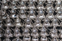 Background from different oriental teapots in a souk.