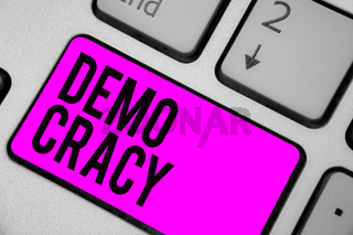Text sign showing Demo Cracy. Conceptual photo freedom of the people to express their feelings and beliefs Keyboard purple key Intention create computer computing reflection document.