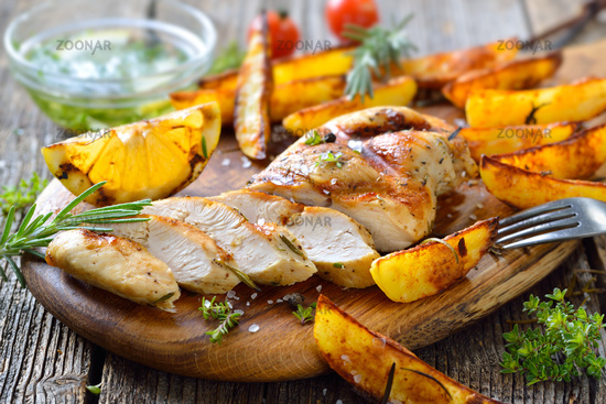 Grilled chicken breast with potato wedges