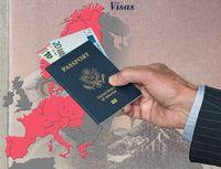 Man holding US passport and Euros on map of Schengen Zone