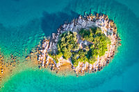 Lonely Mediterranean stone island aerial view