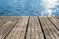 Empty  wooden platform with sea background