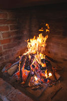 Fireplace fire for preparing traditional croatian dish peka