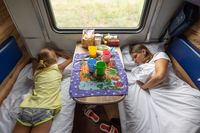 The situation on the train, mom and daughters are sleeping on the lower shelves in the car