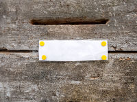 mailbox slot on a wooden door with white paper
