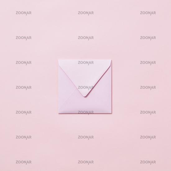 Handcraft envelope mockup for post card on a pastel pink background.