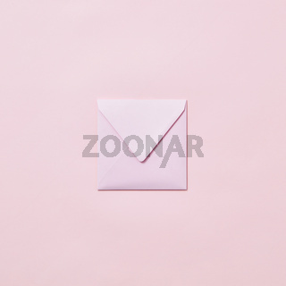 Handcraft envelope mockup for post card on a pastel pink background.