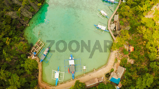 Very beautyful lagoon with boats. Paradise islands in Philippines. Kayangan Lake. Fisheye view.