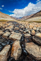 Mountain stream with stones in Himalayas