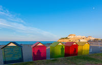 Colorful beach huts on Peniscola beach