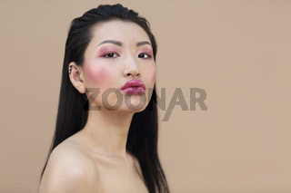 Beauty portrait of young attractive asian woman with bright make up