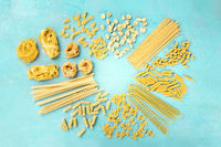 Italian pasta, flat lay banner with copy space, shot from the top on a blue background, a design template with a place for text