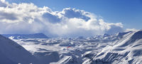 Speed flying in sun winter mountains