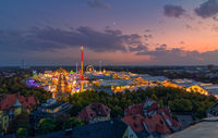 Oktoberfest in Munich from a high view at sunset.