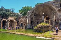 Tivoli Italy tourist woman italian archaeological site Villa Adriana Hadrians Villa Serapeo Canapeo Canopus area pool temple
