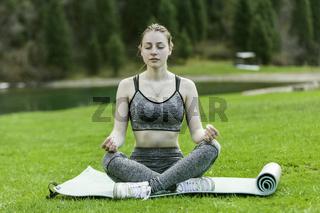 Meditation on a green lawn