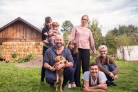 portrait of happy family at farm