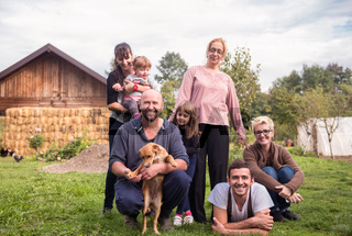 portrait of happy family at farm