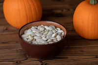 Pumpkina and seeds on wood