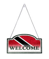 Trinidad and Tobago welcomes you! Old metal sign isolated