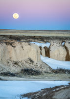 Full moon rise over prairie
