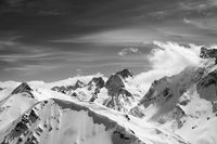 Black and white winter mountains with snow cornice