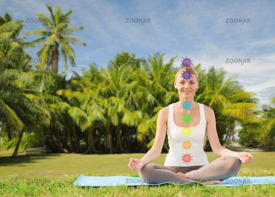 couple doing yoga in lotus pose with seven chakras