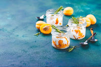 Natural yogurt with pieces of apricots and rosemary