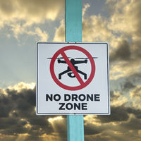 No Drone zone sign against the sky