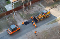 fixing road, asphalt, excavator people