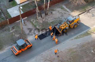 fixing road, asphalt, excavator people