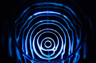 Sound waves in the dark. Blue color